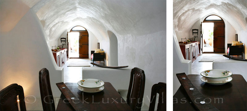 A luxurious dining room in a villa with a pool in a traditional village in Santorini