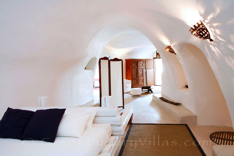 The cave style bedroom of  the villa in a traditional village in Santorini