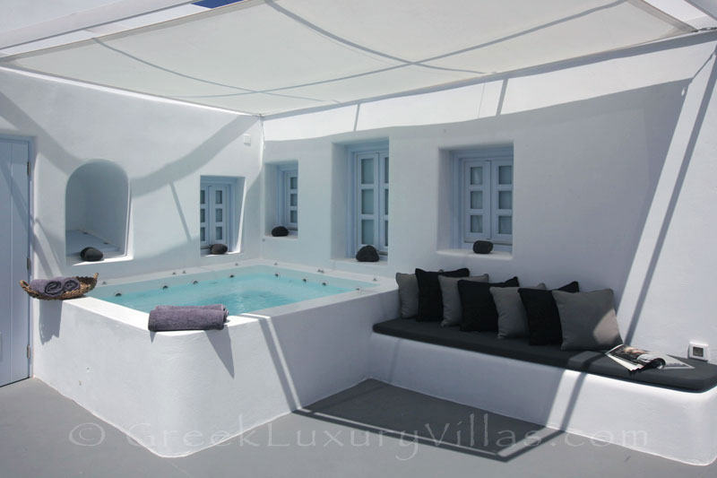 A contemorary luxury villa with a jacuzzi in Santorini