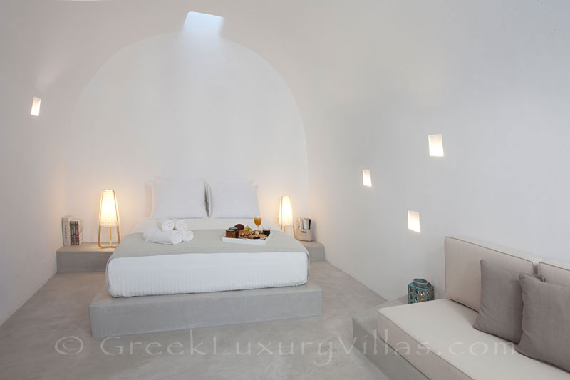 A cave bedroom in a contemporary luxury villa in Santorini