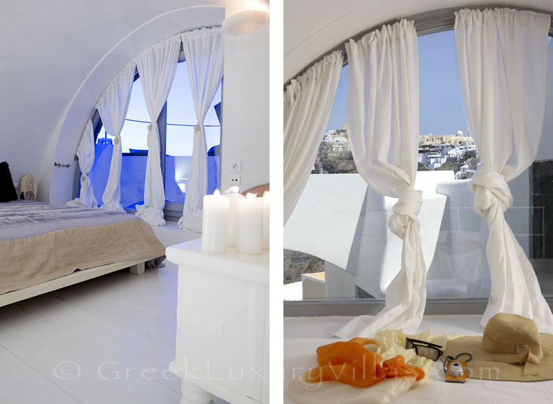 A bedroom of a luxury villa in Fira, Santorini, with sunset view