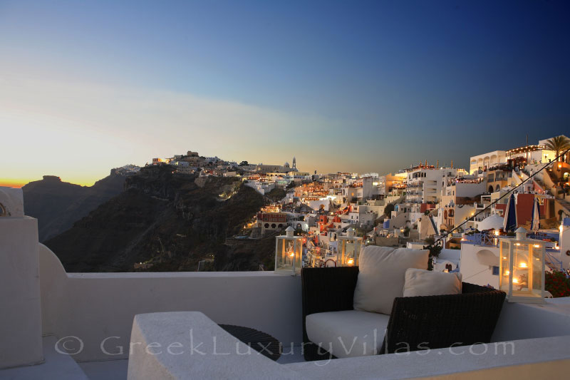 Sunset view from a rooftop jacuzzi of a luxury villa in Fira, Santorini