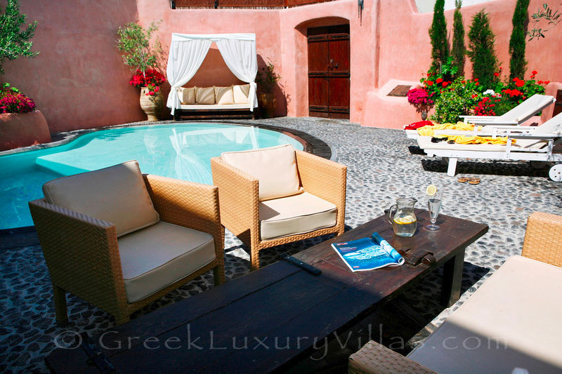 The courtyard of the traditional village house with a pool in Santorini