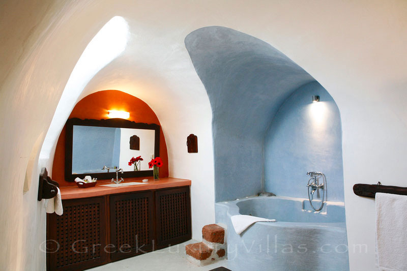 A bathroom of a traditional village house with a pool in Santorini