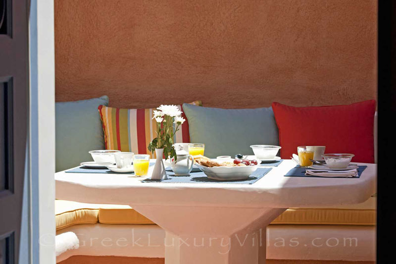 Breakfast in the courtyard of a mansion luxury villa in Oia, Santorini
