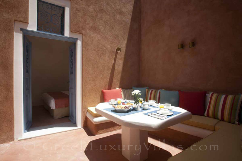 Breakfast in the courtyard of the mansion luxury villa in Oia, Santorini