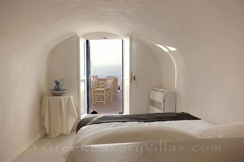 An aegean bedroom of a mansion luxury villa in Oia, Santorini