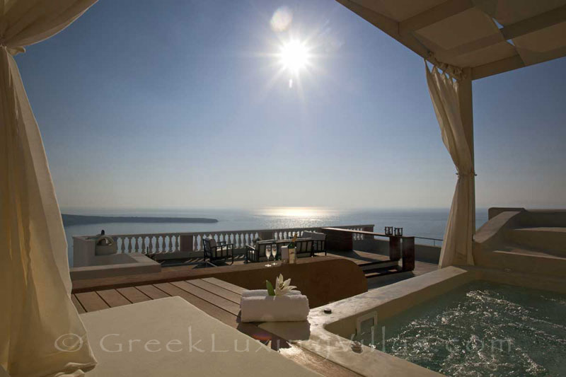 Panoramic view from the roof terrace of a luxury villa in Oia, Santorini