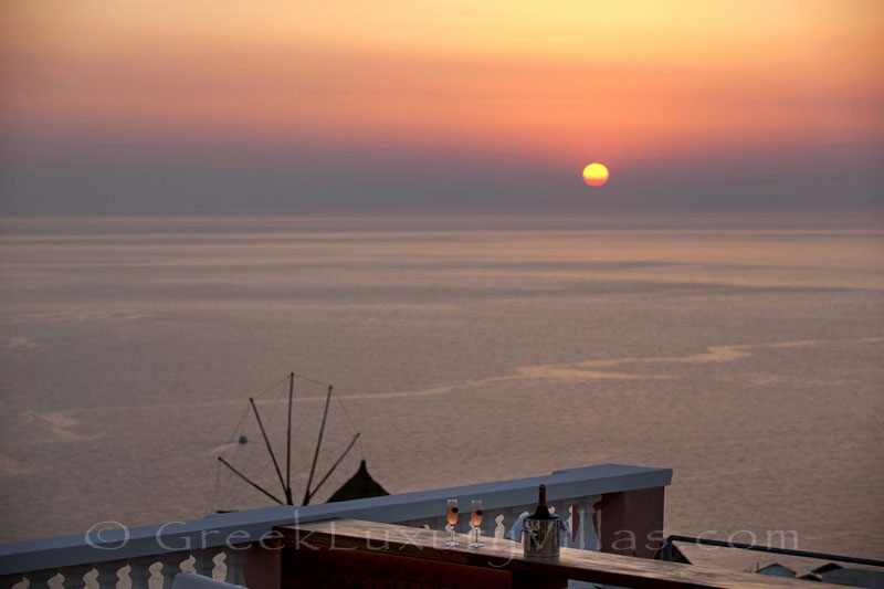 Panoramic sunset view from the roof terrace of the luxury villa in Oia, Santorini