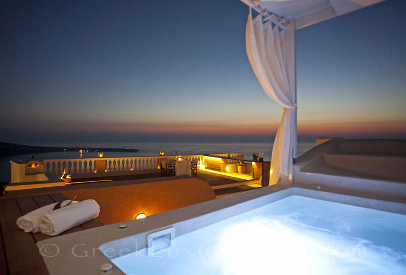 Panorama sunset from the whirlpool bath of luxury villa in Oia, Santorini