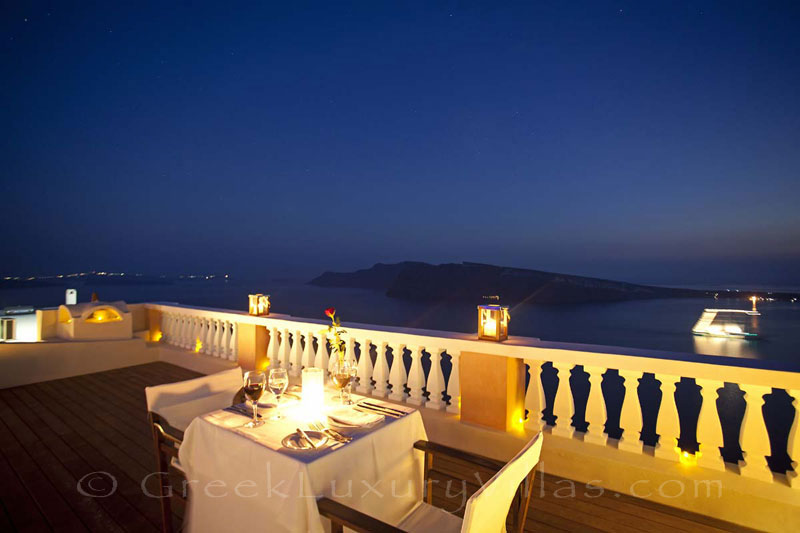 Dinner at sunset having a panorama view from a luxury villa in Oia, Santorini