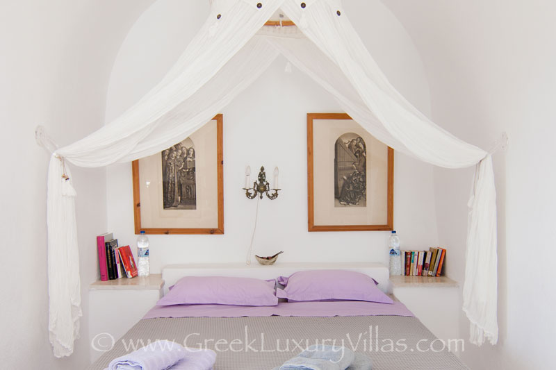 A bedroom with chapel in large villa with a pool on the cliff of Santorini