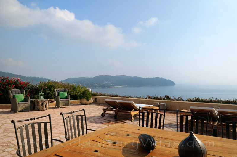 Dining with sea view at luxury villa with private beach in Skiathos