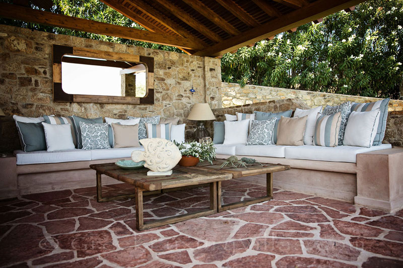 Outdoor lounge of luxury villa with private beach on Skiathos