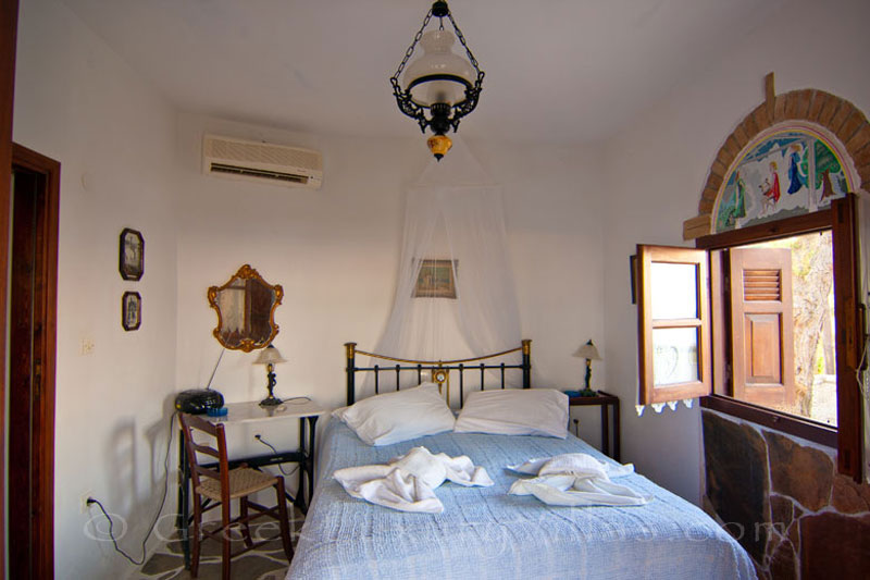 A bedroom with sea view in the windmill with a garden near the beach in Skyros