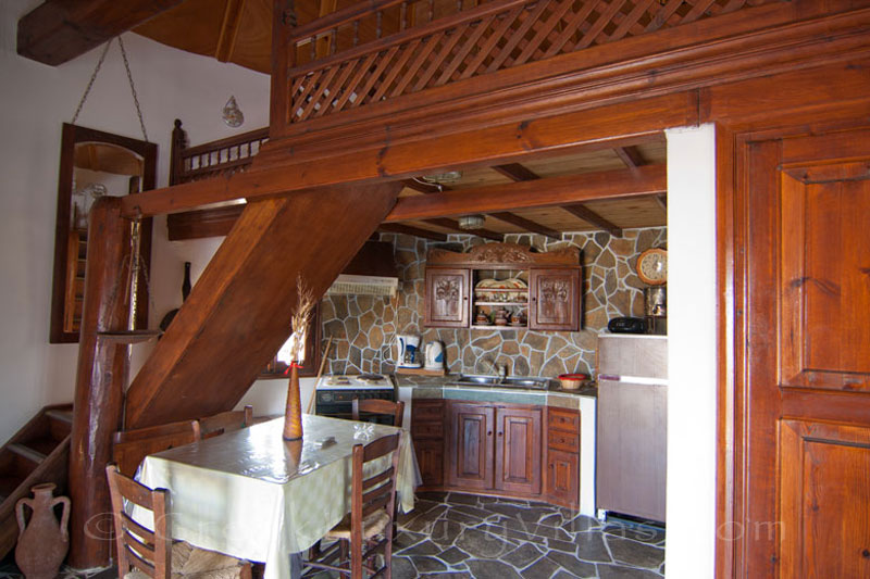 The kitchen and the lounge of a windmill near the beach in Skyros