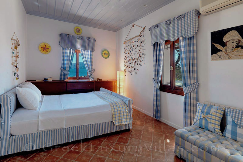 Bedroom of traditional beachfront villa in Skyros
