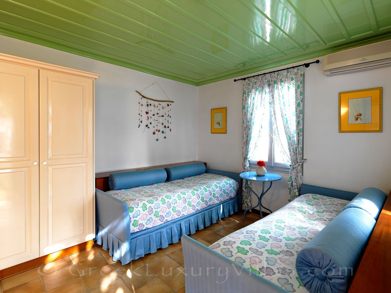 Guest bedroom of beachfront villa in Skyros