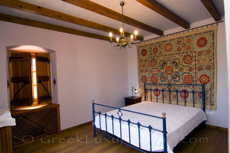 Ambelos's bedroom in a traditional villa in Spetses