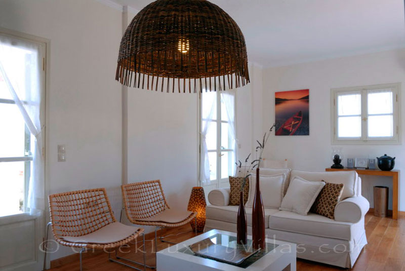 The living-room of a luxury villa with a pool in Spetses