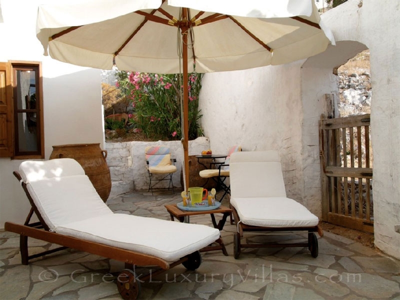 Relaxing on the sun loungers of the neoclassical villa in Symi