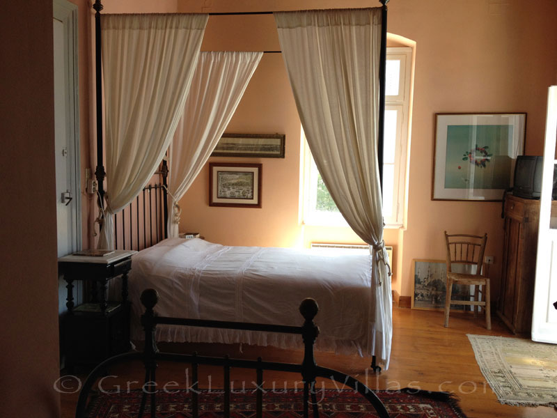 Bedroom of neoclassical villa for large groups on Syros