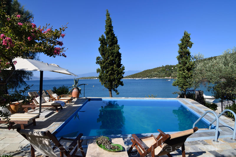 luxury villa with private beach boat chef butler pool sea view