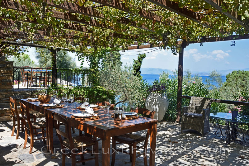 exclusive waterfront villa with private chef butler garden dining area