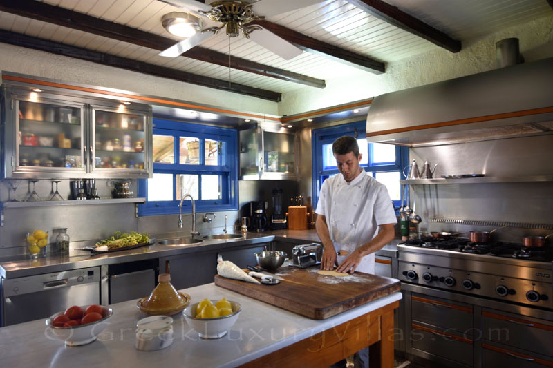 chef at work kitchen of luxury villa with private chef butler boat