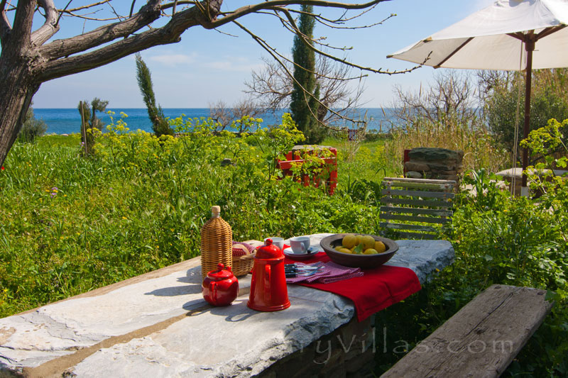 Tinos beach bungalow dining in nature sea view