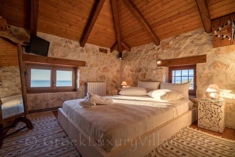 The bedroom of a seafront villa with a pool in Zakynthos