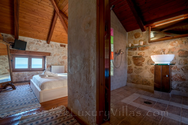 A bedroom of a seafront villa with a pool in Zakynthos