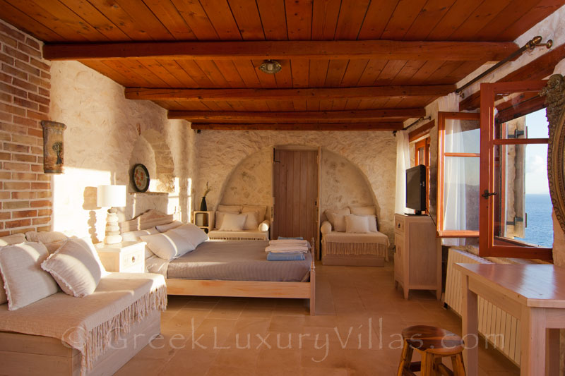 A bedroom of a villa with a pool in Zakynthos