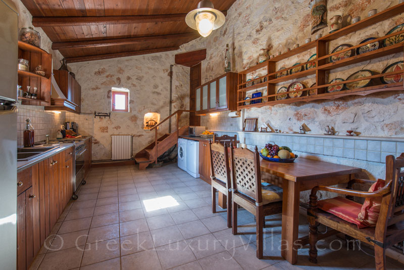 The kitchen of a seafront villa with a pool in Zakynthos