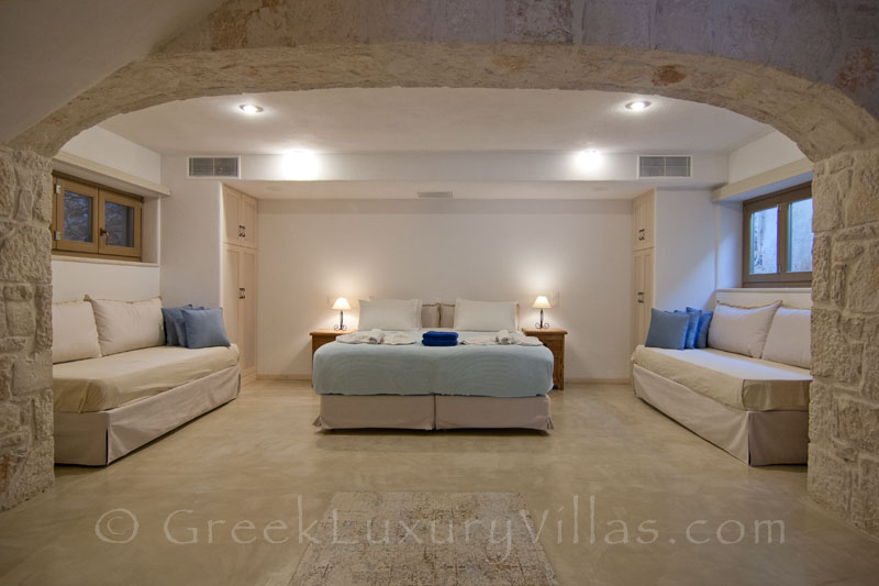 The bedroom of a villa with a pool in Zakynthos