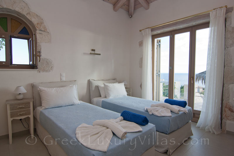 The bedroom of a seaview villa with a pool in Zante