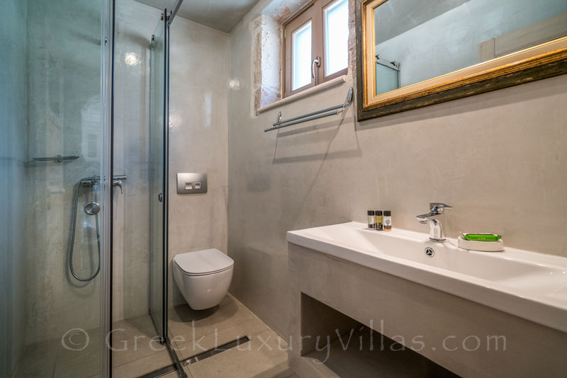 The bathroom of a seaview villa with a pool in Zakynthos