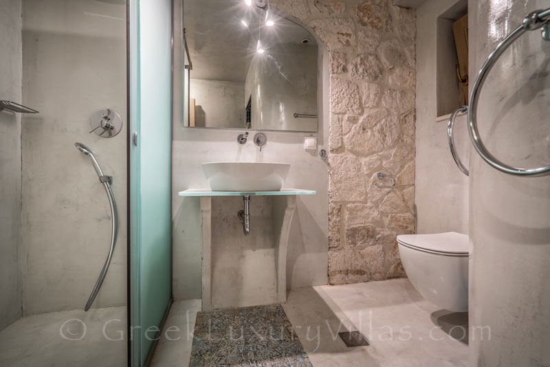 A bathroom of a seaview villa with a pool in Zakynthos