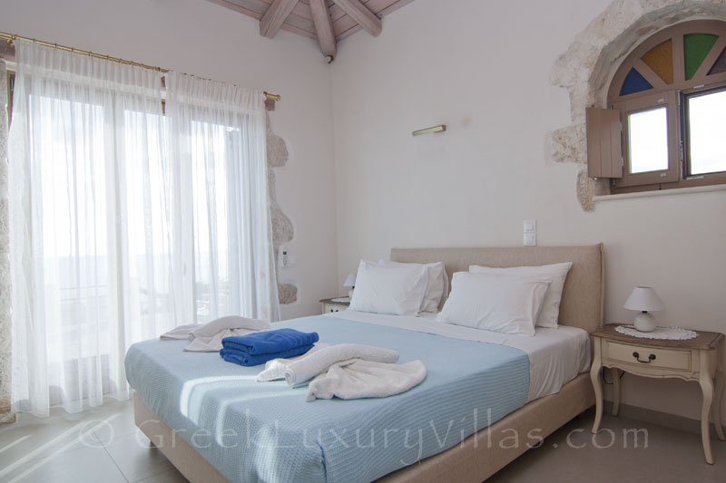 A bedroom of a seaview villa with a pool in ZANTE