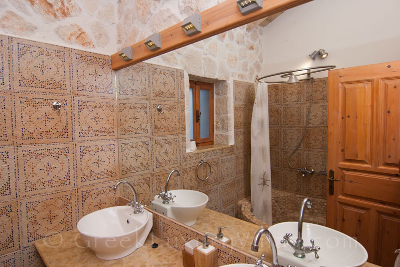 A bathroom of the villa with seaview and a pool