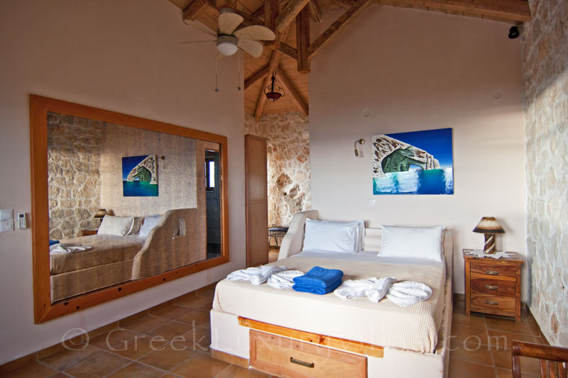 A bedroom of the villa with the pool and seaview