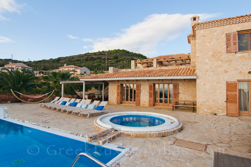 Outdoor pool and jacuzzi of a six-bedroom seafront villa